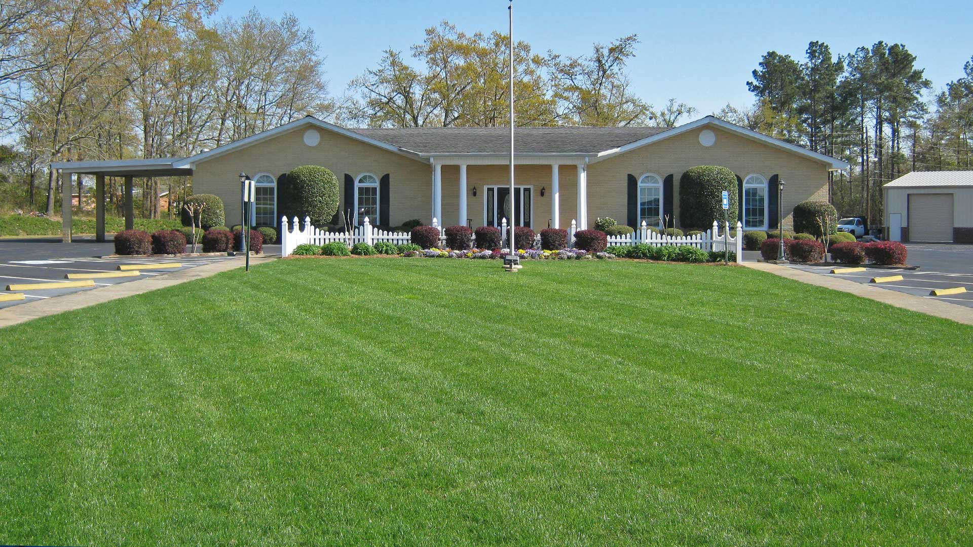 Commercial building in Waynesboro recently mowed, professional landscaping, and annual flower plantings.