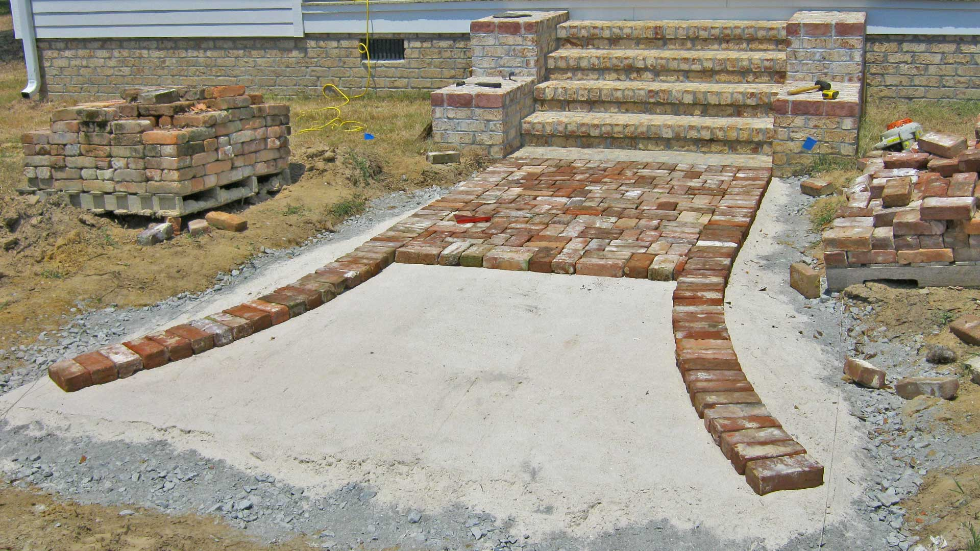 New hardscaping pathway and steps built with pavers in front of a home in Wrens.