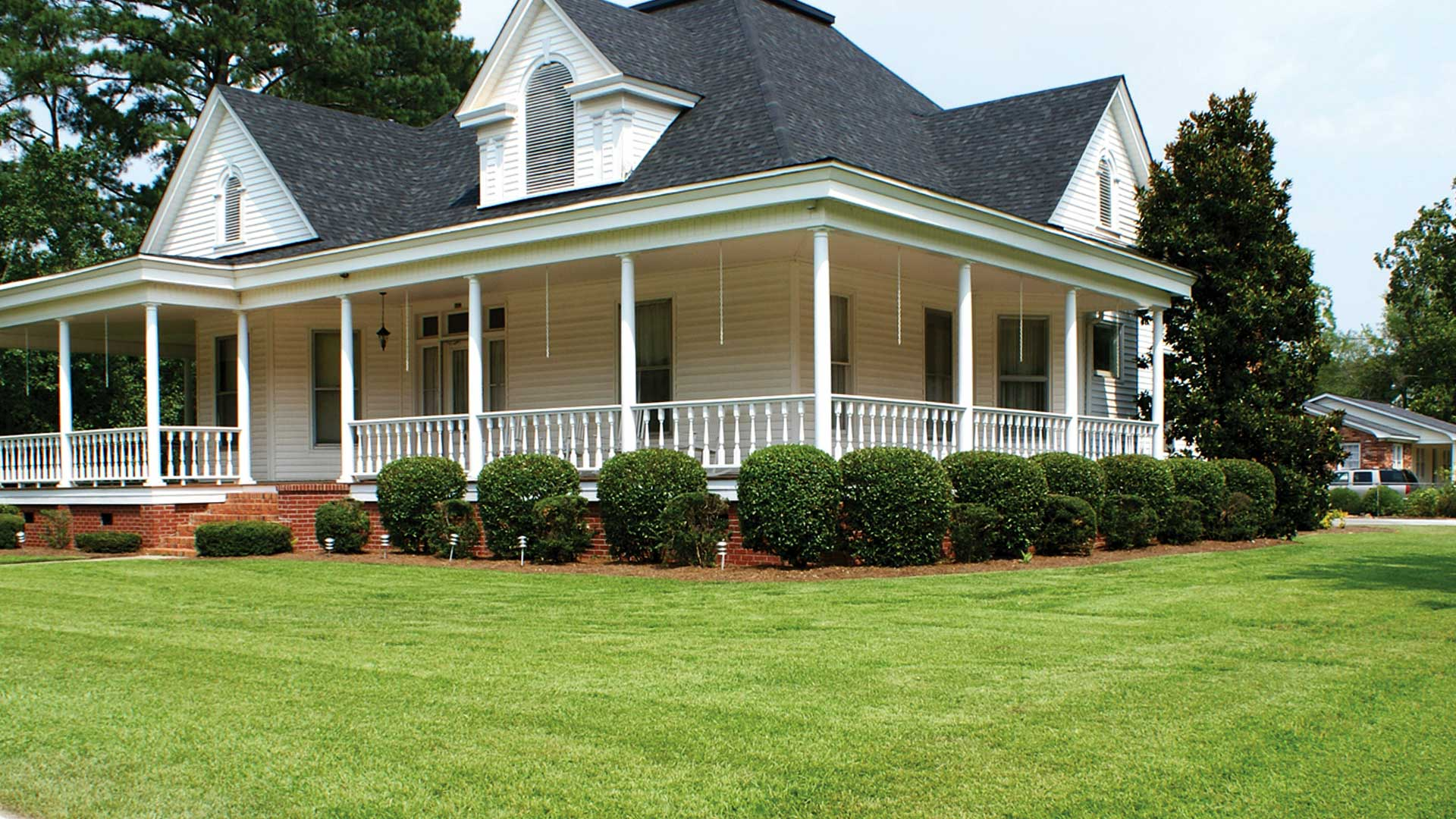 Home in Louisville, GA that we landscaped and provide lawn care.