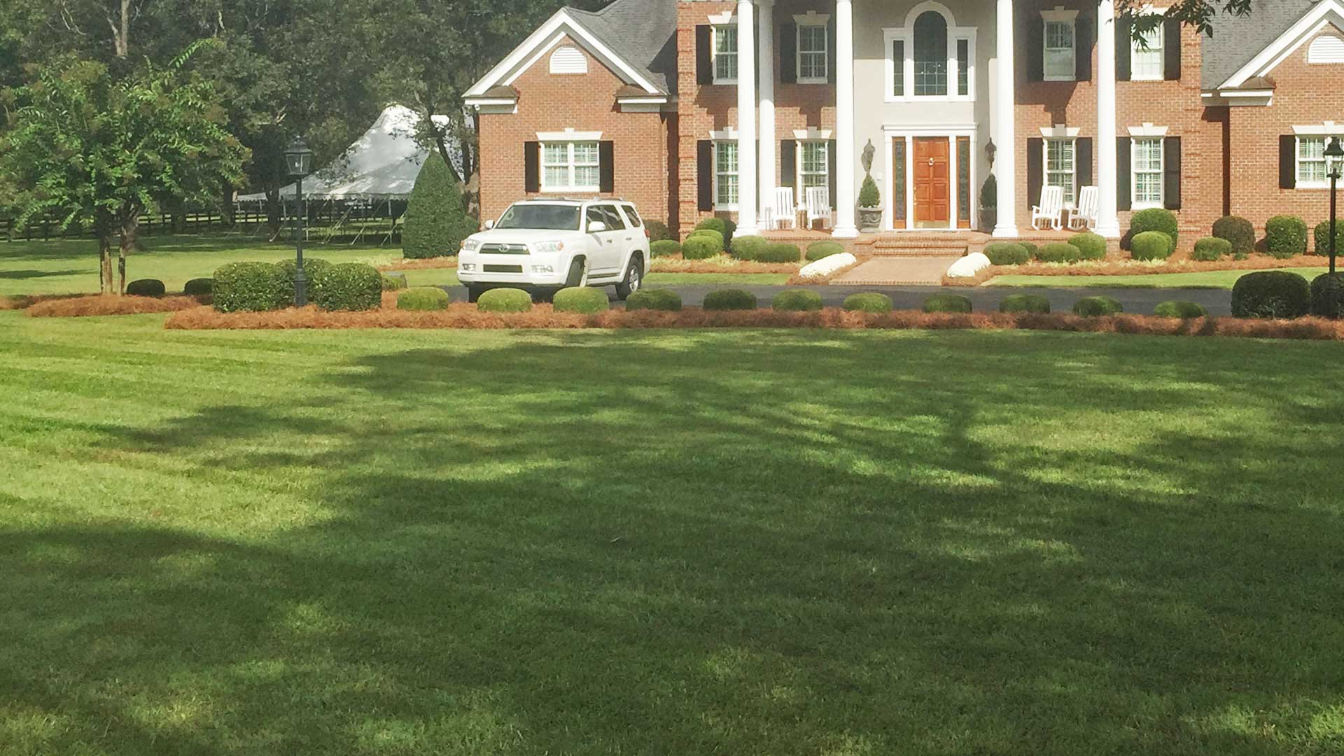 Lawn perfectly mowed in front of a home in Louisville, GA.