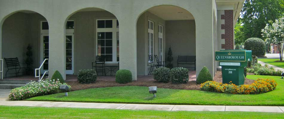 Lawn care and landscaping at office building in Wrens, GA.