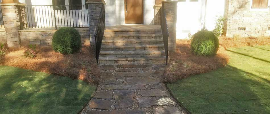 New steps and walkway in front of a Louisville, GA home created with natural stone pavers.