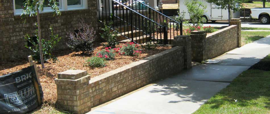 Retaining wall in front of a home in Wrens, GA with new landscape installation.