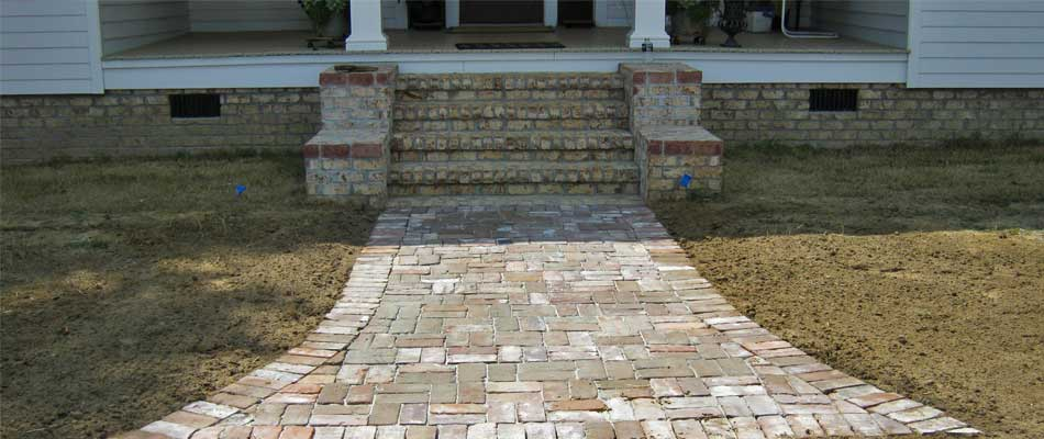 Completed hardscaping project including custom steps and walkway at a home in Waynesboro, GA.